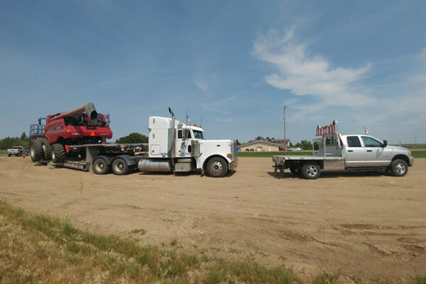 Red Combine Haul with Pilot Truck