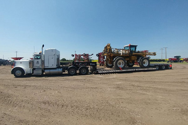 Yellow Sprayer on Flatbed